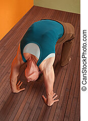 Woman In Urdhva Dhanurasana Yoga Pose