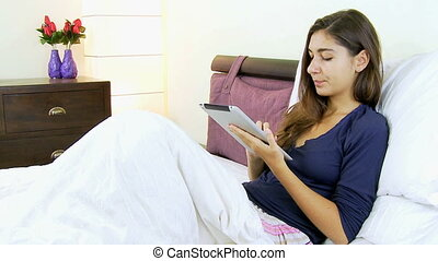 Woman in vacation with tablet happy