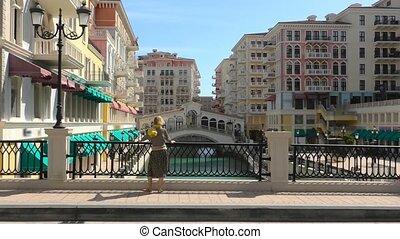 Woman in Venice Doha - Blonde woman on balcony looking...