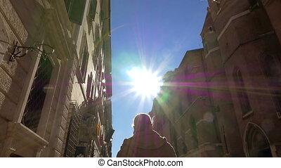 Woman in Via del Babuino street on sunny day