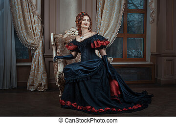 Woman in Victorian dress sitting on a chair in the room.