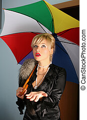 woman in vintage style with fur and umbrella