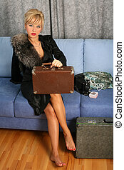 woman in vintage style with suitcase