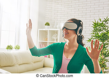 woman in virtual reality glasses.