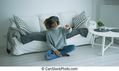 Woman in VR glasses at home