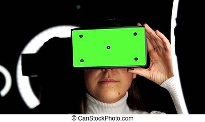 woman in vr glasses over illumination on black - future ...