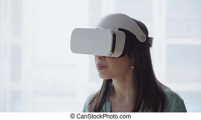 woman in vr head-mounted display - Close up woman's face in...