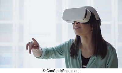 woman in vr head-mounted display - Young brunette woman in...