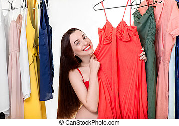 Woman in wardrobe - Young happy woman dressed in underwear ...