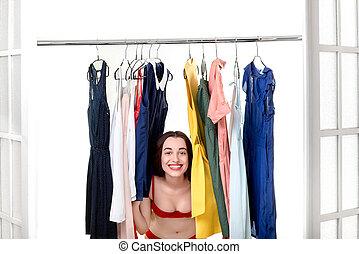 Woman in wardrobe - Young happy woman in underwear looking ...