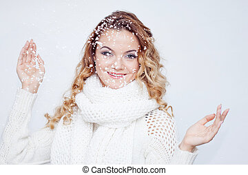 Woman in warm knitted scarf and gloves, portrait on white background, place for your text