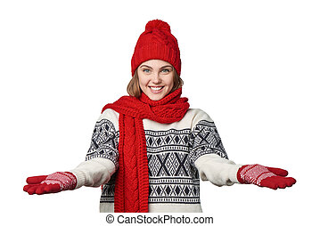 Woman in warm winter clothing with opened arms salutating