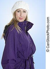 Woman in warm winter jacket