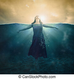 Woman in water - A woman standing in the deep waters with ...