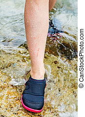 Woman in water shoe