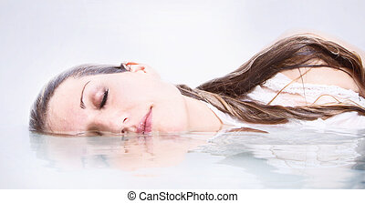 Woman in water with reflection