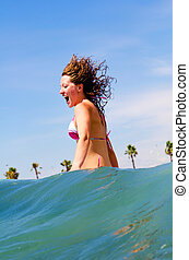 woman in waves