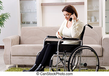Woman in wheelchair at home