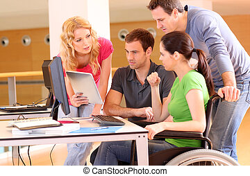 Woman in wheelchair attending group meeting