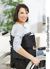woman in wheelchair indoors