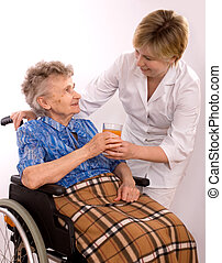 woman in wheelchair - Health care worker and elderly woman...