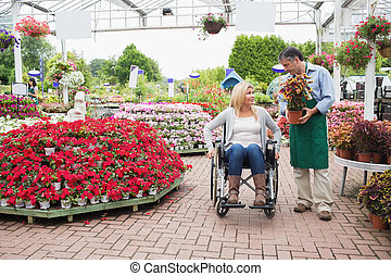 Woman in wheelchair talking to employee