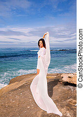 woman in white by the ocean