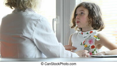 doctor checking her little patient