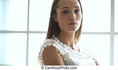Woman in white dress - Fashion. Beautiful woman posing in...