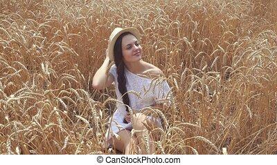 woman in white dress in wheat field