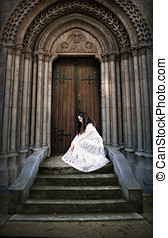 Woman in white dress on stairs - Beautiful young woman in...