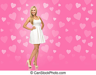 woman in white dress over pink background