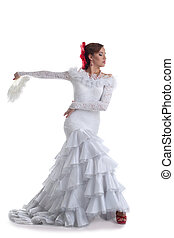 Woman in white dress performing flamenco