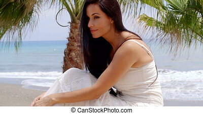 Woman in White Dress Sitting on Beach Wall