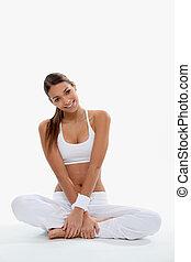 Woman in white gymwear