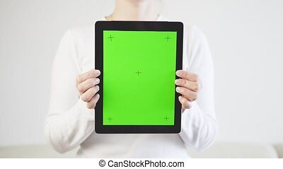 Woman in White Holding Tablet PC