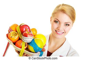 Doctor dietitian recommending healthy food. Diet.