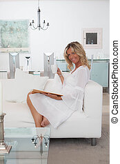 woman in white room relaxing at home