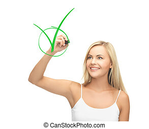 woman in white shirt drawing green checkmark - smiling woman...