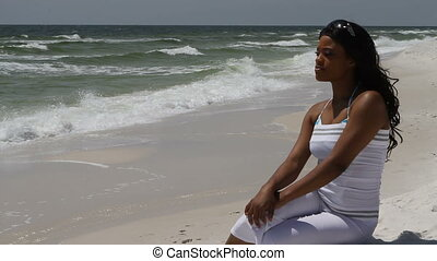 Woman In White Sitting At Beach