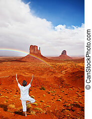 Woman in white under rainbow - Navajo Reservation in the US....