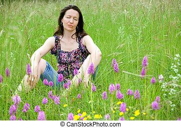 woman in wild flowers