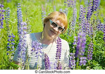 woman in wild lupine