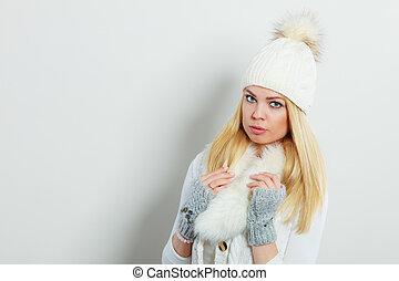Woman in winter clothes woolen cap fur scarf
