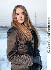 Woman in winter coat outdoors