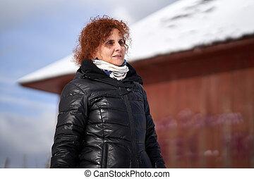 Woman in winter landscape