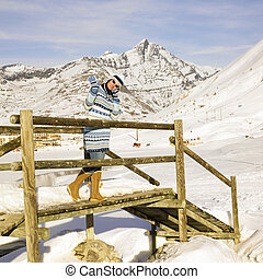 woman in winter mountains