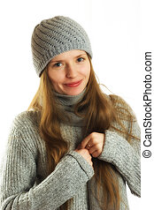 Beautiful woman in a winter outfit, over white and isolated
