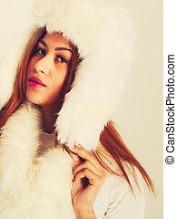 Woman in winter warm clothes fur cap scarf