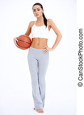 Woman in Workout Outfit Holding Basketball Ball - Full...